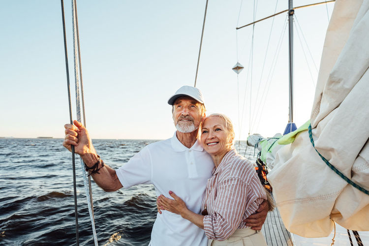 Senior couple travelling on boat