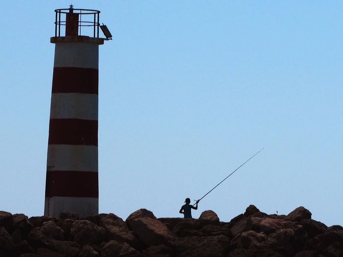 Casting Clear Sky Fishing Fisherman Lighthouse Algarve Portugal