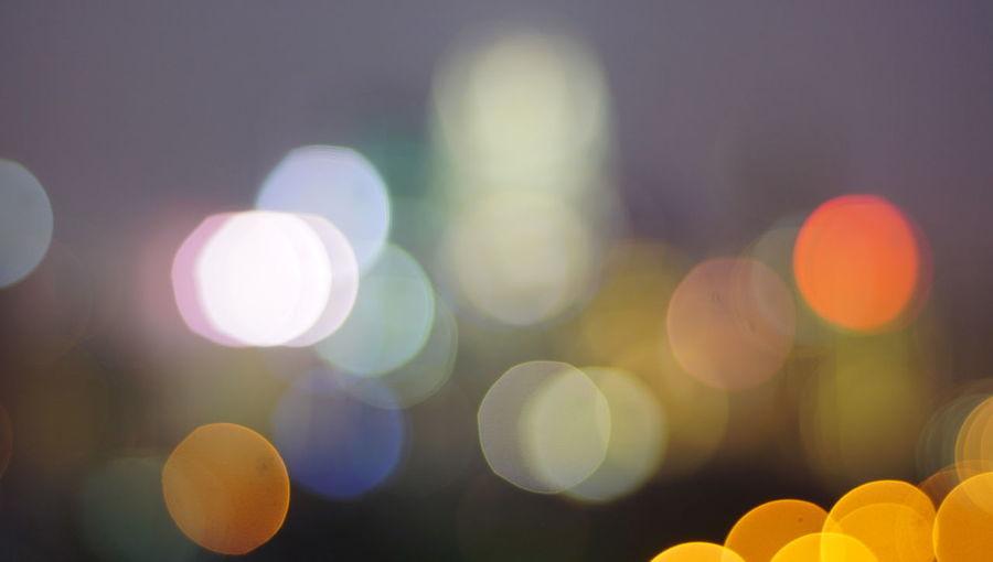 Blurry photo light and bokeh.illuminated at night. Abstract Abstract Backgrounds Backgrounds Circle Defocused Electric Light Geometric Shape Glowing Illuminated Lens Flare Light Light - Natural Phenomenon Lighting Equipment Multi Colored Night No People Orange Color Outdoors Pattern Shape Yellow