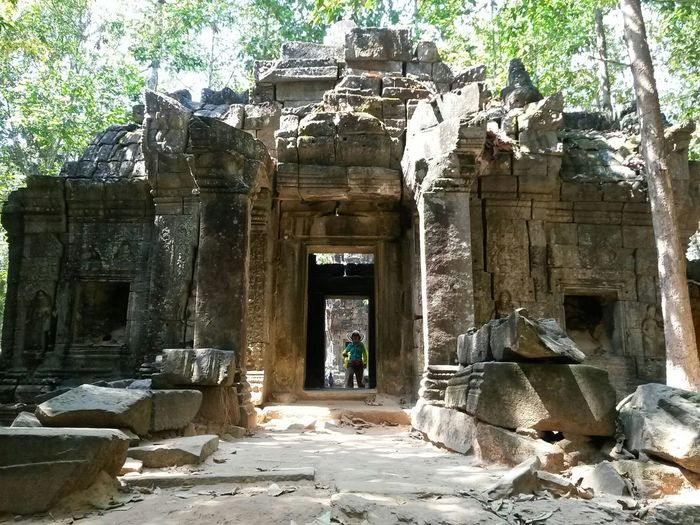 Cambodia South East Asia Ancient Ancient Civilization Angkor Archaeology Architecture Belief Building Built Structure Day History Nature Old Ruin Outdoors Place Of Worship Real People Religion Ruined Solid Spirituality The Past Tourism Travel Travel Destinations