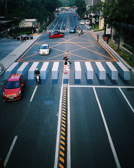 Pedestrian Walkway Pedestrian Timingshot Timing And Luck Visual Creativity City Road Tree Car High Angle View City Street Street Road Marking Traffic Stoplight Crossing