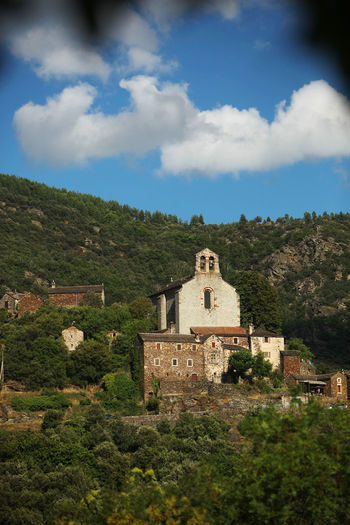 Church Southern France Architecture Belief Building Building Exterior Built Structure Cloud - Sky Clouds And Sky Day History Mountain Nature No People Old Outdoors Place Of Worship Plant Religion Sky The Past Thines Travel Travel Destinations Tree