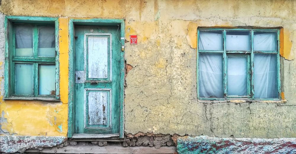 Yellow Blue Colorful EyeEm Best Shots Old Old House Old City Architecture Window Door Abandoned Residential Building Closed Architecture Building Exterior Close-up Built Structure Weathered Closed Door Entryway Front Door Entrance Door Handle Doorway