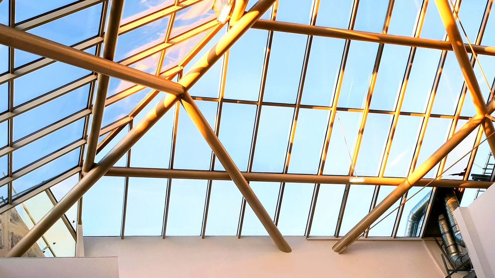 From below the Roof of Market Hall Langenhagen with sunlight reflections on the steel under the blue sky . ... Blue Sky Langenhagen Market Hall Full Frame Window Girder Sky Architecture Close-up Built Structure Skylight Directly Below Cupola Architectural Feature Architectural Design Roof Beam Architecture And Art Tall - High Construction Geometric Shape Architectural Detail Construction Frame Metal Grate