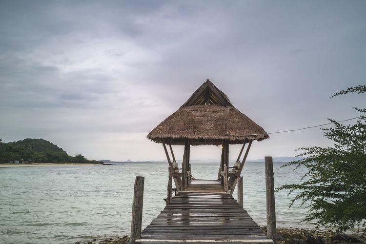 Wooden floor on sea view and beach at koh talu island, prachuap khiri khan, thailand
