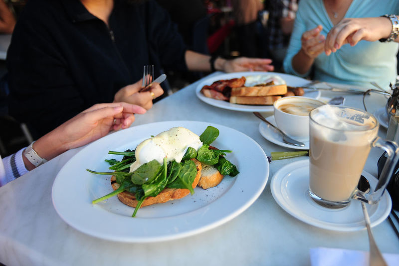 Breakfast Gathering Business Drink Focus On Foreground Food Food And Drink Freshness Frinedship Glass Hand Healthy Eating Incidental People Indoors  Lifestyles Midsection People Plate Ready-to-eat Real People Restaurant Serving Size Table Wellbeing