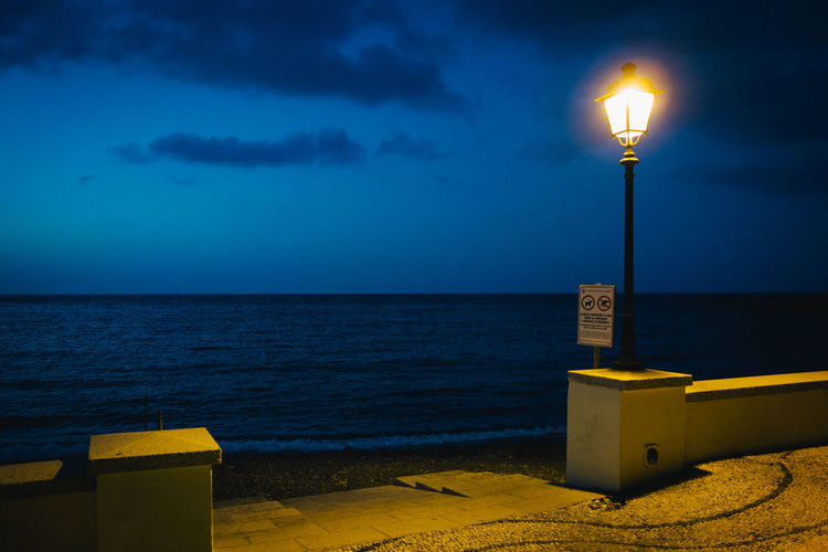 Mediterranean  Street Light Beach Beauty In Nature Cloud - Sky Dusk Electric Lamp Horizon Horizon Over Water Illuminated Land Light Lighting Equipment Nature Night No People Outdoors Scenics - Nature Sea Seascape Sky Street Street Light Water Yellow The Traveler - 2018 EyeEm Awards