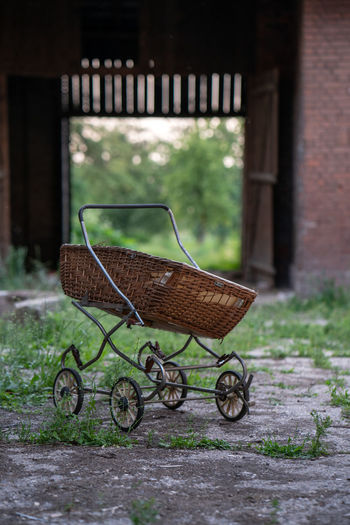 Old antique baby City Abandoned Places Antique Farmhouse Poland Ruins Abandoned Abandoned Buildings Abandoned City Absence Architecture Baby Carriage Building Exterior Built Structure Carriage Cart Day Focus On Foreground Grass Green Color Mode Of Transportation No People Old Outdoors Push Cart Ruin Shopping Cart Transportation Trolley Wheel Wheelbarrow
