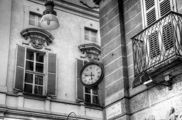 Black & White Black And White Blackandwhite Building Exterior City Clock Clockporn Clocks Clocksoftheworld No People Number Outdoors Street Street Of Turin Text Time Torino Torino ❤ Torinoélamiacittá Turin Turin (Italy) Turin Italy Via Garibaldi Wall - Building Feature Window