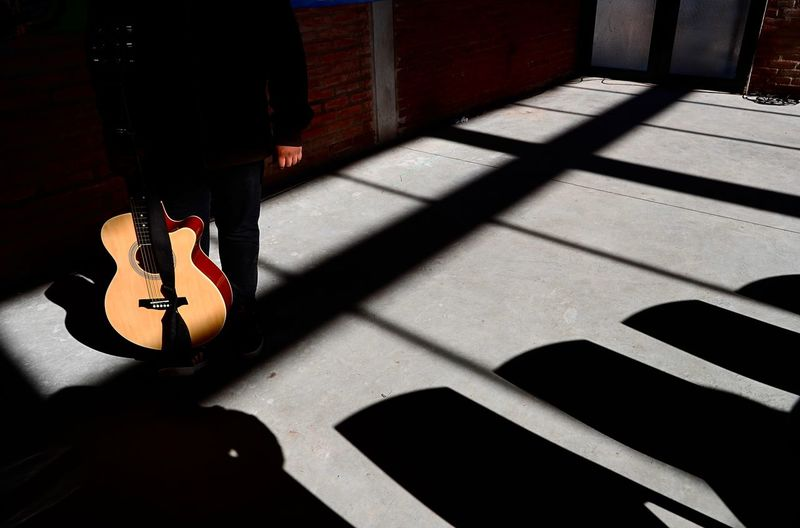 Absence Acoustic Guitar Arts Culture And Entertainment Day Focus On Shadow Guitar High Angle View Indoors  Music Musical Equipment Musical Instrument Musical Instrument String Nature No People Shadow Still Life String String Instrument Sunlight Sunny Wood - Material