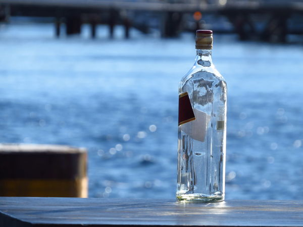 After The Party Afterparty Alcohol Alcohol Bottles Booze Bottle Bottles Collection Drinking Empty Empty Bottles Flask Focus On Foreground Glass Glass - Material Hangover Jar Liquor Morning Ocean Outdoors Schnaps Sea The Morning After Water Waterfront