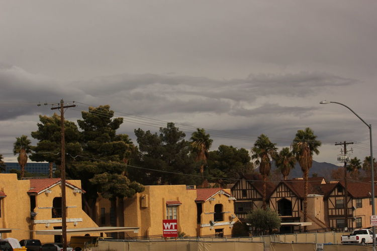 Tompkins condominiums Architecture Building Exterior Built Structure City Cloud - Sky Cloudy With A Chance Of Rai Day Extreme Weather House Nature No People Outdoors Palm Tree Residential Building Sky Storm Storm Cloud Thunderstorm Tornado Tree