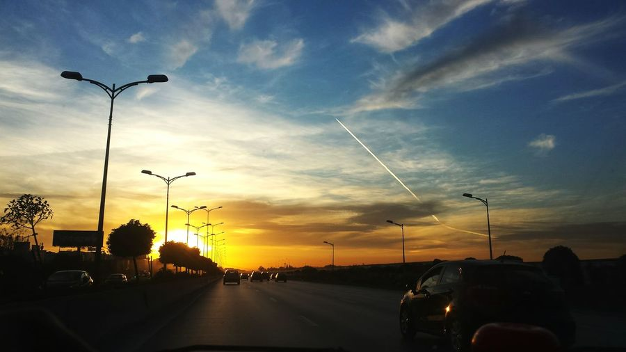 Car Sunset Cloud - Sky Transportation Mode Of Transport Land Vehicle Sky Capture The Moment Street Light Road Travel No People Outdoors Nature Day Highway Mobility In Mega Cities