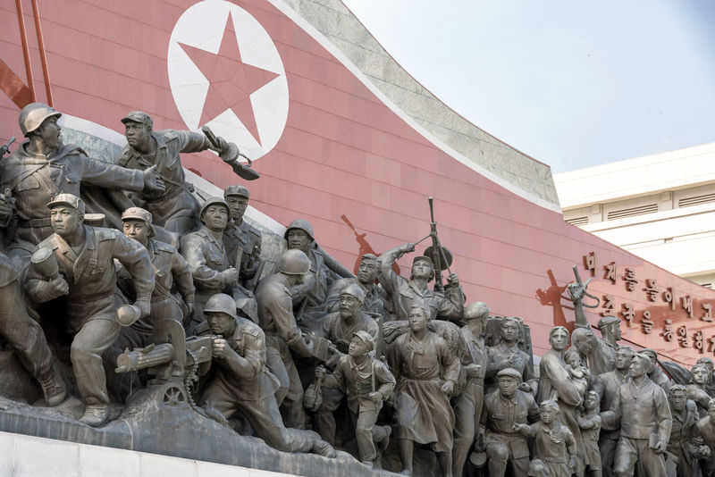 The Grand Monument on Mansu Hill (Mansudae) is a complex of monuments in Pyongyang, North Korea. The central part of the monument are two 22 meters high statues of North Korean leaders Kim Il-sung and Kim Jong-il, made of bronze. Behind the statues is a wall of the Korean Revolution Museum building, displaying a mosaic mural showing a scene from Mount Paektu, considered to be the sacred mountain of revolution. Next to the statues, leading away from the building, there are two monuments showing many different soldiers, workers, farmers, and so on; Anti-Japanese Revolutionary Struggle and Socialist Revolution. Communist Monument DPRK DPRKorea Juche Kim Il Sung Kim Jong Il Korea Korean North Korea Socialist Realism Built Structure Day Sky Socialist