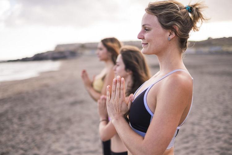 Women exercising at beach