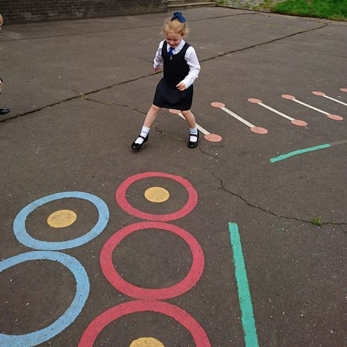 High angle view of girl playing in schoolyard
