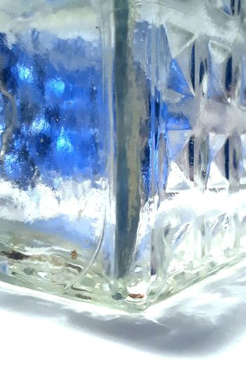 Distortion in blue abstract Liquor Decanter Abstract Full Frame Close-up Indoors  Blue Colors Through Glass