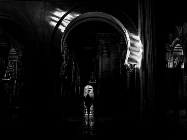 Mezquita-Catedral de Córdoba Architecture Arch Real People Indoors  Built Structure Building Standing Two People Rear View Adult Women Dark Full Length Men Lifestyles People Night Religion Córdoba Mezquita Fujifilm Fujifilm_xseries Fujifilm X30 Walking Arcade