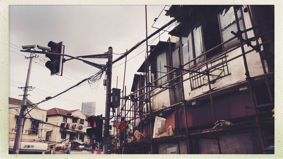 Streetphotography Built Structure Architecture Building Exterior Transfer Print Auto Post Production Filter Low Angle View Sky Nature City No People Lighting Equipment Decoration Residential District Industry Day Power Line  Electricity  Building Outdoors Cable