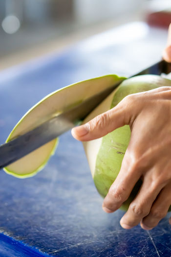 Midsection of person holding fruit