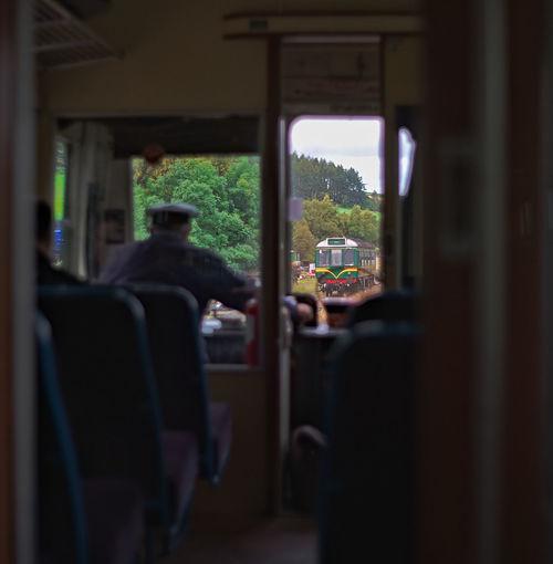 Rear view of man seen through window