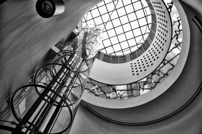 Architectural Feature Architecture Nikon Built Structure Circle Contemporary Cutting Design Directly Below Edge Elevator Found On The Roll Geometric Shape Glass Library Lift Low Angle View Modern Modern Science Sky Skylight Spiral The Architect - 2016 EyeEm Awards Your Design Story