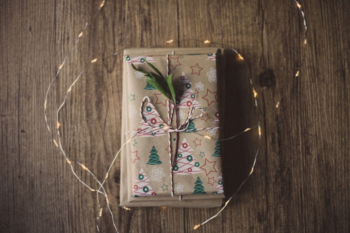 Wrapped gifts on wooden table Christmas Holiday Love Wrap Christmas Chritsmas Chritsmas Lights Close-up Day Decoration Directly Above Gift High Angle View Indoors  No People Paper Ribbon - Sewing Item Table Wood - Material Wrapped