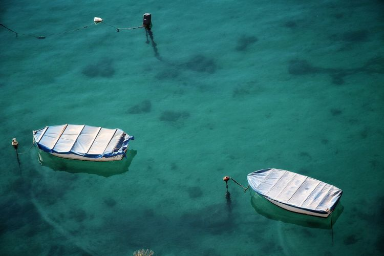 High Angle View Of Covered Boats Moored On Sea