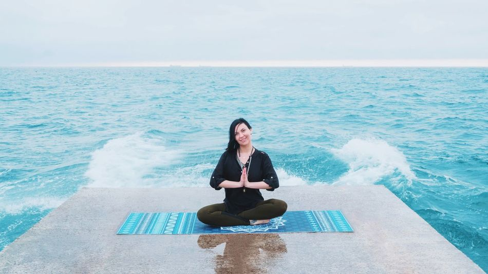 Sea Sitting Full Length Horizon Over Water Calm Water Front View Yoga Sky Scenics Cross-legged Relaxation Waves Beauty In Nature Leisure Activity Lifestyles Tranquil Scene Tranquility Young Adult Nature Meditation Namaste... Lotus Seaside Elements