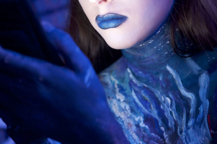 Close-up midsection of girl in blue lipstick