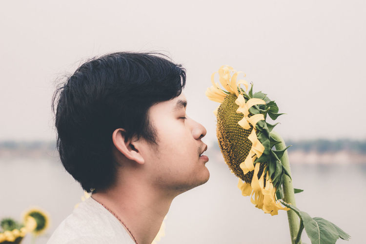I am smelling the flowers in my garden. Close-up Color Film Flower Garden Fresh Lifestyles Nature Outdoors Plant Portrait Smell Sunflowers Thailand