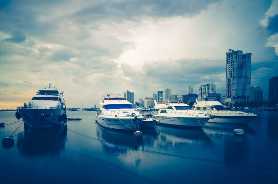Reflection Nautical Vessel Sea Travel Destinations Cloud - Sky Yacht Water Marina No People Transportation Skyscraper Harbor Sky City Moored Building Exterior Outdoors Architecture Cityscape Urban Skyline Manila Manila Bay  Harbor Square, Manila