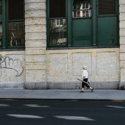 Woman walking at the SidewalkAcross on 19thstreet NYC Streetphotography 50mm urban people instapeople Manhattan