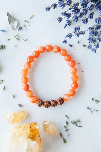 Citrine Bracelet Energy Healing Crystal Jewelry EyeEm Selects Food And Drink No People Indoors  Orange Color Wellbeing Directly Above Creativity Still Life Freshness Shape High Angle View Geometric Shape Circle Orange