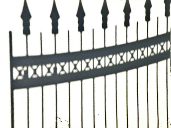 Creative Light And Shadow Light And Shadow Blackandwhite Black & White Black And White Fence Figure Architectural Detail Streetphotography Street Photography Simplicity Minimalism Minimalobsession