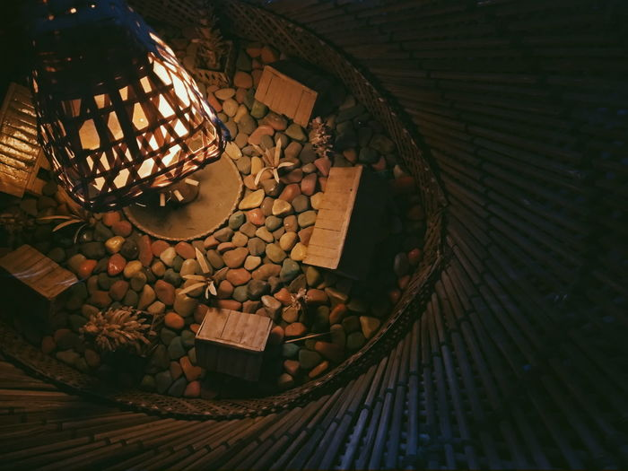 High angle view of illuminated lantern on table