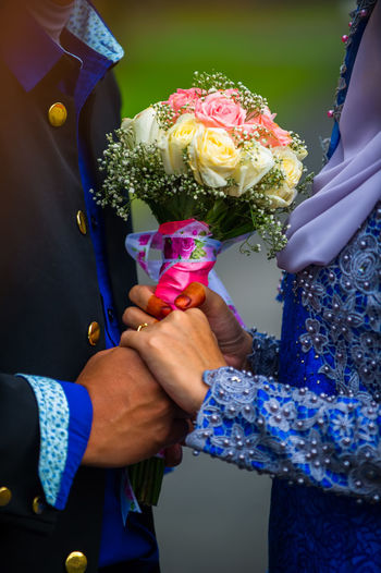 bride hand couple holding colorful bouquet Bonding Bouquet Bride Bridegroom Celebration Celebration Event Ceremony Couple - Relationship Flower Groom Holding Human Hand Life Events Love Men Midsection New Life Real People Rose - Flower Togetherness Two People Wedding Wedding Ceremony Wedding Dress Women