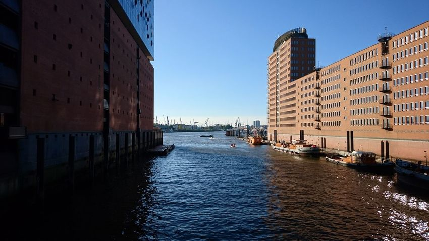 Shadow of the Elbphilharmonie. Hamburg Germany Hh Hamburg Meine Perle Elbphilharmonie Elphi Elbe Elbe River River Waterfront View On The River Water Hanseatic Blue Sky Light And Shadow Shadow Shadows Architecture Travel Destinations Business Finance And Industry Building Exterior Sky City Water