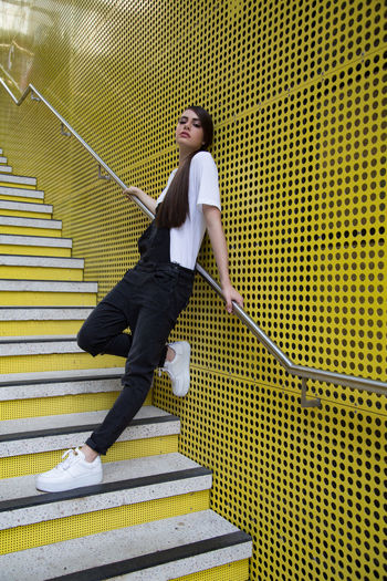 Imogen Architecture Casual Clothing Clothing Day Emotion Fashion Photography Fashion&love&beauty Full Length Leisure Activity Lifestyles Metal Motion One Person Railing Real People Side View Staircase Steps And Staircases Women Yellow Color Young Adult Young Women The Fashion Photographer - 2018 EyeEm Awards