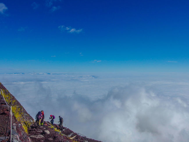 hiking people group going to the top of Fuji mountain. Sky Cloud - Sky Beauty In Nature Group Of People Leisure Activity Blue Nature Real People Scenics - Nature Lifestyles Hiking Day Mountain People Men Adventure Landscape Environment Travel Tranquility Outdoors Looking At View Top Fuji Moutain