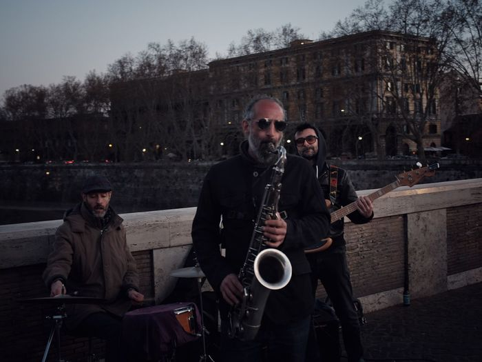 Roman Nights Rome Streetphotography Men Music Adult Musical Instrument Sitting Togetherness Musician Group Of People People Arts Culture And Entertainment Leisure Activity Males  Artist Outdoors