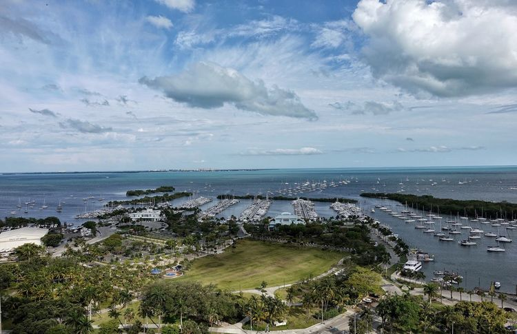 Coconut Grove, Miami FL. Dinner Key. Horizon Over Water Sky Sea Water Nature Scenics Cloud - Sky Beauty In Nature Tranquil Scene Tranquility Day Beach Outdoors No People Grass Miami Coconut Grove Marina Miami FL Usa 🇺🇸☀️ Cloud