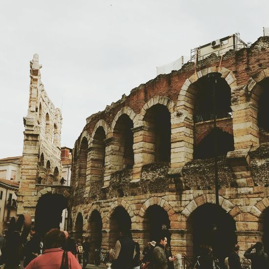 Verona Verona Italy History Ancient Travel Destinations Built Structure Architecture Tourism Lifestyles Tourist Large Group Of People Old Ruin Sky The Past Travel Arch Men City Building Exterior Leisure Activity Outdoors Real People Arena Di Verona Arena Di Verona, Italy