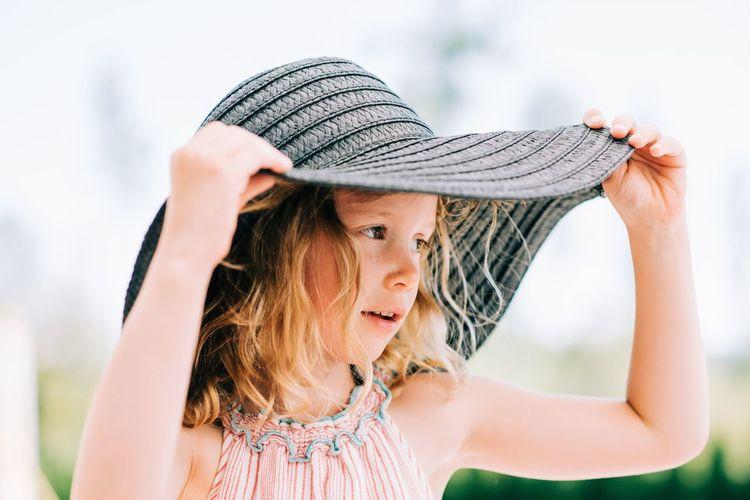 Portrait of cute girl in hat