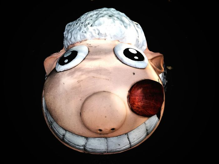 Close up on face of sheep doll is smiling with black background in art and design concept Happiness Colors White Red Black Cartoon Cute Smile Doll Decoration Face Animal Sheep Clay Doll EyeEm Selects Eye Black Background Adult Make-up Disguise Close-up Eyelash Facial Mask - Beauty Product