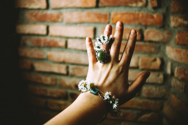 Adult Brick Wall Close-up Daisy Day Human Body Part Human Finger Human Hand One Person Outdoors People Real People Ring Spring Women