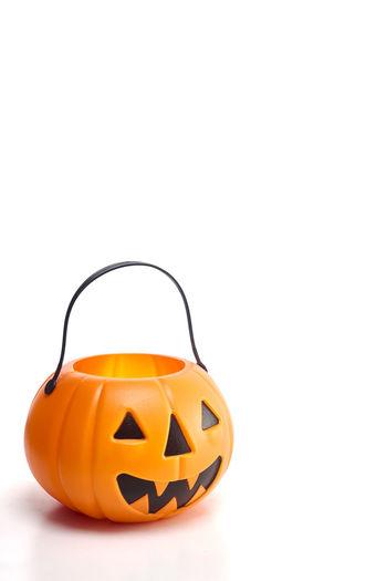 Close-up of jack o lantern against white background