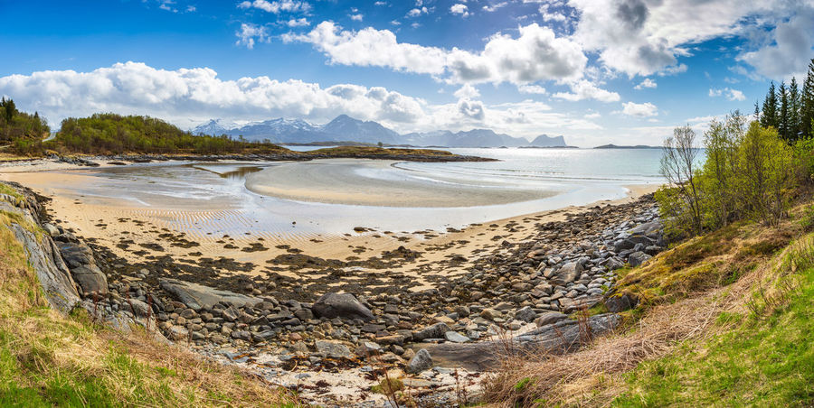landscape view of Senja Island in Norway Barents Sea, Northern, Senja Island, Arctic, Atlantic, Coast, Cold, Europe, Fishing, Fjord, Harbor, Holiday, Ice, Landscape, Mountains, Nature, Nordic, North, North Sea, Norway, Norwegian, Ocean, Outdoor, Polar Circle, Port, Scandinavia, Sea, Seascape, Sky, Spring, Summer, Tourism, Travel, Village, Water Water Cloud - Sky Land Beach Scenics - Nature Sky Beauty In Nature Sea Nature Day Tranquility Tranquil Scene No People Non-urban Scene Plant Outdoors Idyllic Remote Sand