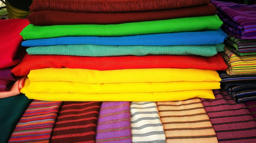 Multi Colored Backgrounds Market Retail  Textile Variation Stack For Sale Business Finance And Industry Close-up Fabric Cloth Colorful Street Market