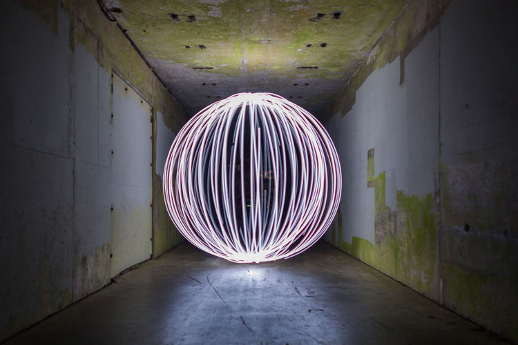 Light Light Painting Orb Orbiting Circle Design Direction Geometric Shape Illuminated Long Exposure Long Expsoure Motion Night No People Pattern Shape Tunnel Wall - Building Feature